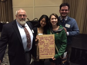 """Tom Hubbard, GALA Board member presents PrismND Officers with poster from 1972 """"Out of the Closet"""" Dance"""